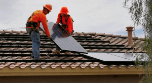 Electricians install solar panelElectricians install solar panel